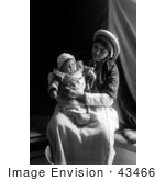 #43466 Rf Stock Photo Of A Ramallah Woman Holding Her Baby In Her Lap