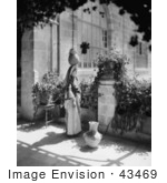 #43469 Rf Stock Photo Of A Black And White Ramallah Woman Balancing A Jug On Her Head On A Patio