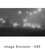 #495 Black And White Picture Of A Cars Stopped At A Traffic Light And Foggy Weater