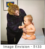 #5133 Stock Photography Of A Physician Examining A 9 Month Old Baby