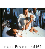 #5169 Picture Of A Doctor Examining A Child With Polio Disease