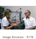 #5176 Picture Of A Nurse Checking A Male Patient'S Blood Pressure