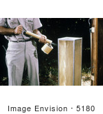 #5180 Stock Photography Of A Field Researcher Using A Hand-Held Sprayer To Knock Down Mosquitoes From The Screen Of A Horse Stable Mosquito Trap