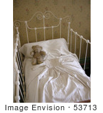 #53713 Royalty-Free Stock Photo Of A Teddy Bear In A Baby Crib