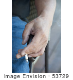 #53729 Royalty-Free Stock Photo Of A Hand Holding Cigarette