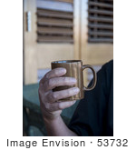 #53732 Royalty-Free Stock Photo Of A Man Holding A Hot Drink In A Mug