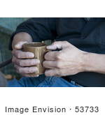 #53733 Royalty-Free Stock Photo Of A Man Holding A Hot Drink In A Mug