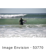 #53770 Royalty-Free Stock Photo Of A Surfer In The Waves