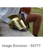 #53777 Royalty-Free Stock Photo Of A Man Sitting By A Helmet