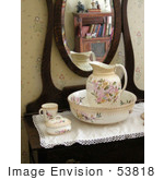 #53818 Royalty-Free Stock Photo Of A Vintage Water Pitcher By A Mirror