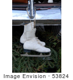 #53824 Royalty-Free Stock Photo Of A Pair Of Ice Skates Hanging From A Bumper