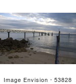#53828 Royalty-Free Stock Photo Of A Pier And Pelican On A Beach