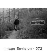 #572 Black and White Photograph of a Man Walking on Da-Ku-Be-Te-De Trail by Jamie Voetsch
