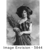 #5844 Woman In Serape Holding Wheat