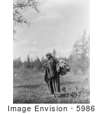 #5986 Cree Woman Carrying Moss