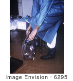 #6295 Picture of a Doctor Putting On Plastic Boot Covers by KAPD