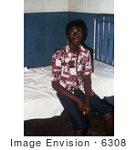 #6308 Picture Of A Patient Recuperating From Lassa Fever Sitting On A Bed In The Male Ward Of The Segbwema Sierra Leone Clinic