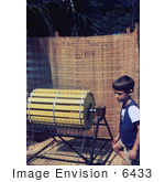 #6433 Picture Of A Boy Standing Beside A Rice Threshing Machine At A 1976 Sierra Leone Lassa Fever Field Study