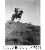 #7041 Stock Photography: Apsaroke Man With Bow And Arrows On Horse