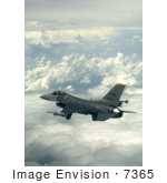 #7365 Stock Image Of An F-16 Fighting Falcon Above The Clouds