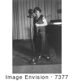 #7377 Stock Photo of Renee Chemet in Front of Microphone, Holding Violin by JVPD