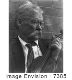 #7385 Stock Photograph Of A Man Holding Violin
