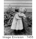 #7455 Stock Image of a Little Boy and Girl Kissing by JVPD