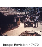 #7472 Picture of a Person Issuing Ration Cards to African People in Port Harcourt, Nigeria During the Nigerian-Biafran War by KAPD