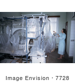 #7728 Picture of South African Virologist Adjusting Plastic Ebola Virus Isolators by KAPD