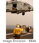 #8846 Picture Of A Person Directing A Seahawk Helicopter