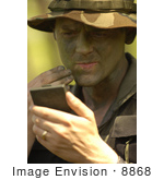 #8868 Picture Of A Soldier Applying Camouflage Paint
