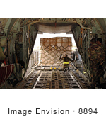 #8894 Picture Of A Soldier Loading A C-130 Aircraft