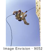 #9052 Picture Of A Soldier On A Rock Wall