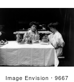 #9667 Picture Of Two Women Using A Toaster At A Table