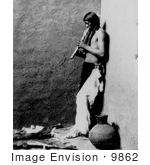 #9862 Picture Of An American Indian Playing An Instrument by JVPD
