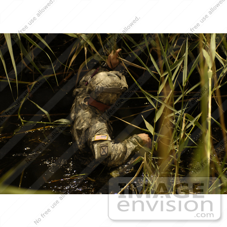 #10584 Picture of an Army Soldier Wading in Water by JVPD