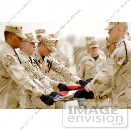 #10781 Picture of Honor Guardsmen Folding a Flag by JVPD