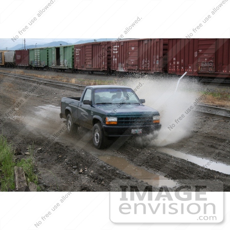 #12 Picture of an Off-Road Enthusiast Driving Through Muddy Terrain by Kenny Adams