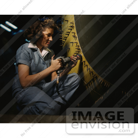#1241 Stock Photo of a Riveter Woman Working on a Consolidated Bomber by JVPD