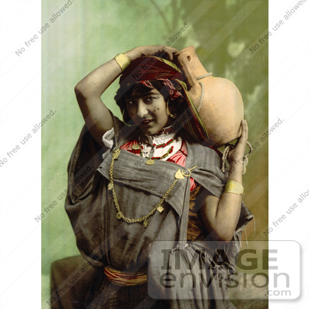 #13419 Picture of a Bedouin Woman Carrying a Pottery Vessel by JVPD