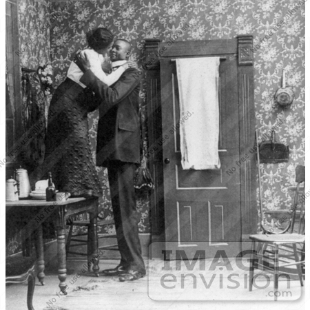 #16208 Picture of a Short Woman Standing on a Table, Embracing a Tall Man by JVPD