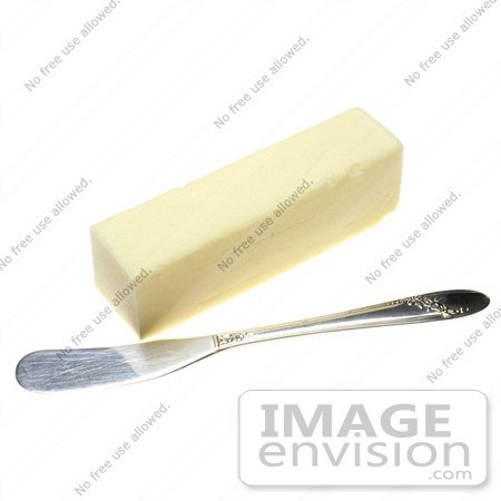Picture of a Butter Knife Resting Beside an Unwrapped ...