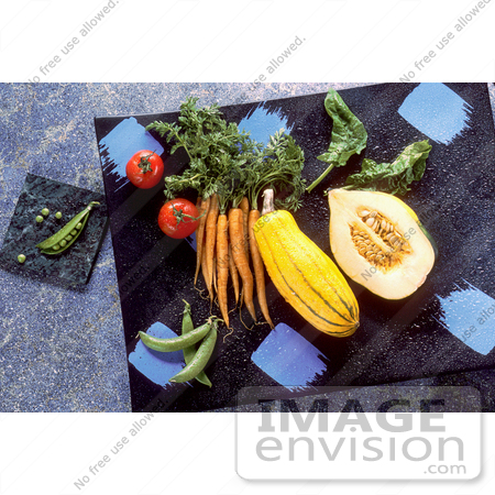 #17133 Picture of Veggies (Pease, Tomatoes, Carrots, Squash, Spinach and Green Beans) on Marble Cutting Boards on a Counter Top by JVPD