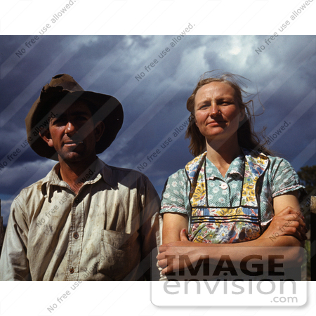 #17872 Photo of a Farmer Husband and Wife Against a Stormy Sky by JVPD