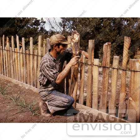 #17875 Photo of a Homesteader and Farmer Repairing a Wooden Slab Fence by JVPD