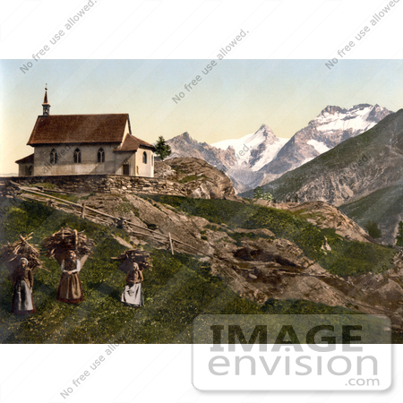 #17973 Picture of Children With Baskets of Firewood Near a Church, Saas Fee Near Rimpfischhorn Mountain, Valais, Switzerland by JVPD