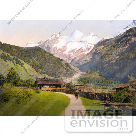 #18249 Photo of a Man on a Path by Chalet Buildings, View of Blumlisalp, Bernese Oberland, Switzerland by JVPD