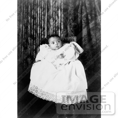 #18562 Photo of African American Baby Wearing a Christening Gown, Awaiting a Baptism by JVPD