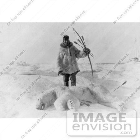 #18697 Photo of a Male Eskimo Hunter Man With Bow and Arrows, Standing Over a Killed Polar Bear by JVPD