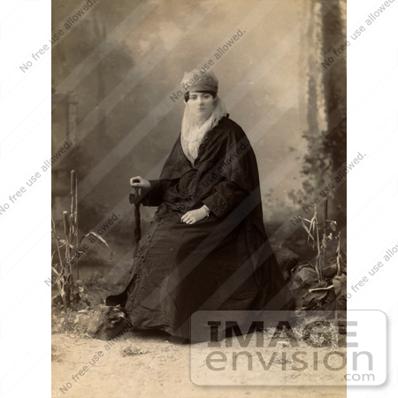 #19098 Photo of a Turkish Woman Wearing a Niqab Veil on Her Face, Sitting in a Chair, Holding a Parasol by JVPD